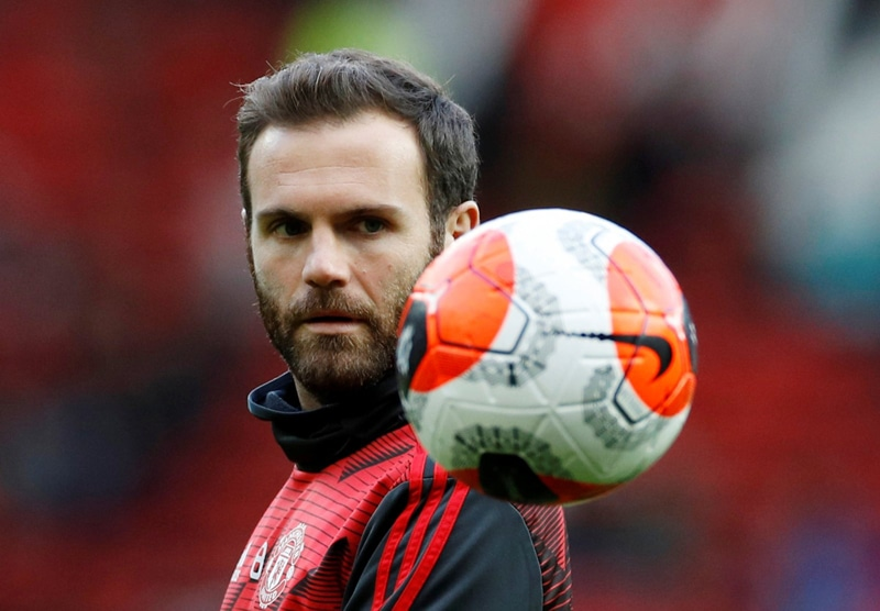 Manchester United midfielder Juan Mata is a footballer making a difference